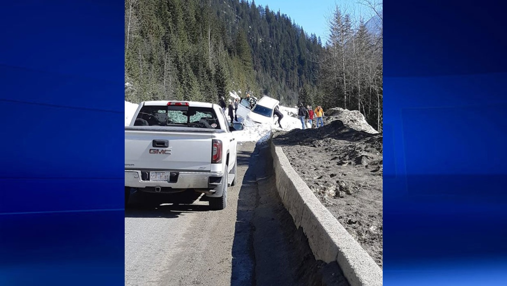 Natural avalanche buries both lanes of Highway 1, nearly swallows car