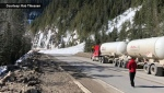 Driver caught in avalanche