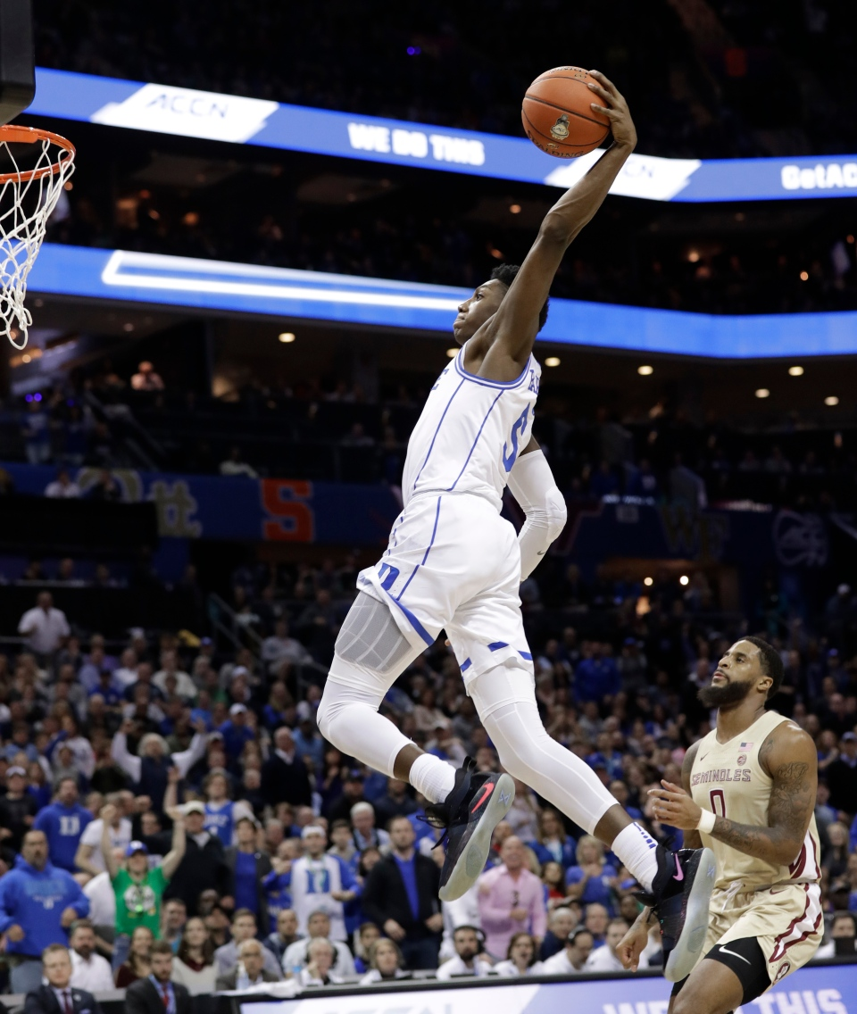 Duke's RJ Barrett goes up to dunk against Florida State during the first half of the NCAA college basketball championship game of the Atlantic Coast Conference tournament in Charlotte, N.C., Saturday, March 16, 2019. (AP Photo/Chuck Burton)