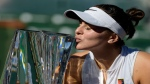 Bianca Andreescu, of Canada, kisses her trophy after defeating Angelique Kerber, of Germany, in the women's final at the BNP Paribas Open tennis tournament Sunday, March 17, 2019, in Indian Wells, Calif. Andreescu won 6-4, 3-6, 6-4. (AP Photo/Mark J. Terrill)