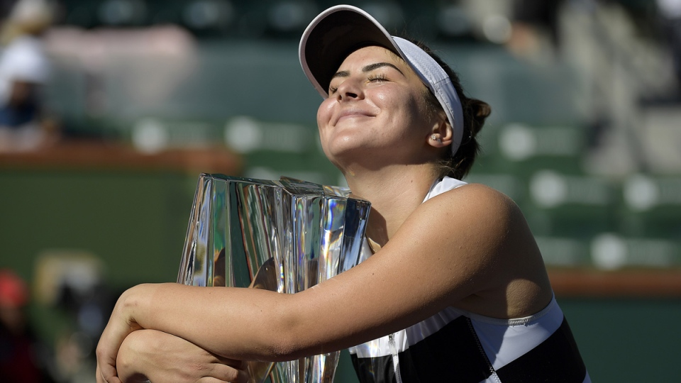 Bianca Andreescu hugs her trophy after defeating Angelique Kerber in the women's final at the BNP Paribas Open tennis tournament on March 17, 2019. (Mark J. Terrill / AP)