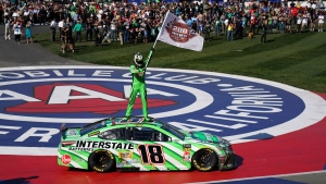 Kyle Busch stands on his car after winning the NASCAR Cup Series auto race at Auto Club Speedway in Fontana, Calif., Sunday, March 17, 2019. The win was the 200th for Busch across NASCAR's three national series. (AP Photo/Rachel Luna)