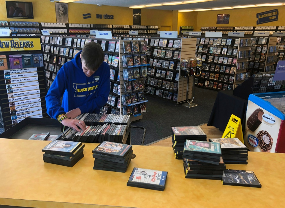 a68896a3509b Employee Ryan Larrew alphabetizes returned movies before re-shelving them  at the last Blockbuster store on the planet in Bend