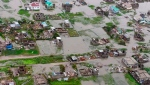 This image made available by International Federation of Red Cross and Red Crescent Societies (IFRC) on Monday March 18, 2019, shows an aerial view from a helicopter of flooding in Beira, Mozambique. (IFRC) via AP)