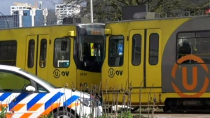 In this image taken from video, a body lays next to a tram as emergency services attend the scene of a shooting in Utrecht, Netherlands, Monday March 18, 2019. (AP Photo)