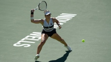 Bianca Andreescu, of Canada, returns a shot to Angelique Kerber, of Germany, during the women's final at the BNP Paribas Open tennis tournament Sunday, March 17, 2019, in Indian Wells, Calif. (AP Photo/Mark J. Terrill)