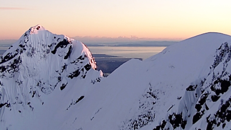The North Shore mountains are seen during a Chopper 9 flight at sunset in March 2019. (CTV News Vancouver)