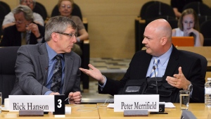 Rick Hanson, chief of the Calgary Police Service, and Peter Merrifield, president of the Mounted Police Association of Ontario, appear at Senate national security committee to discuss harassment in the RCMP on Monday, May 27, 2013. (THE CANADIAN PRESS/Sean Kilpatrick)