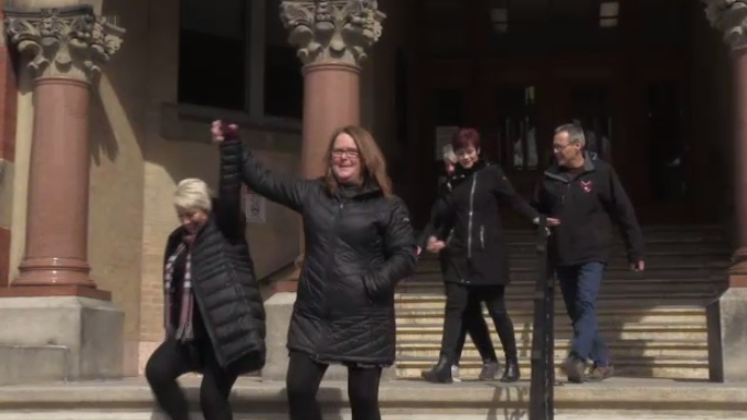 CUPE union members celebrate as judge rules in favour of their battle with the New Brunswick government.