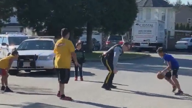 An unknown Surrey Mountie pulled over on March 17 to play basketball with a group of kids.