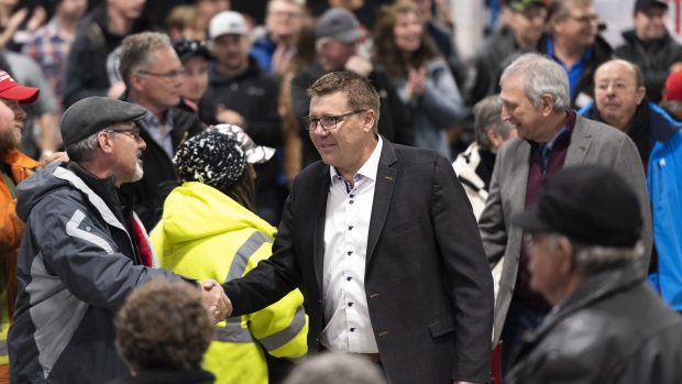 Saskatchewan Premier Scott Moe walks through the crowd to speak at a pro-pipeline rally at IJACK Technologies Inc. near Moosomin, Sask., on Saturday February 16, 2019. (THE CANADIAN PRESS/Michael Bell)