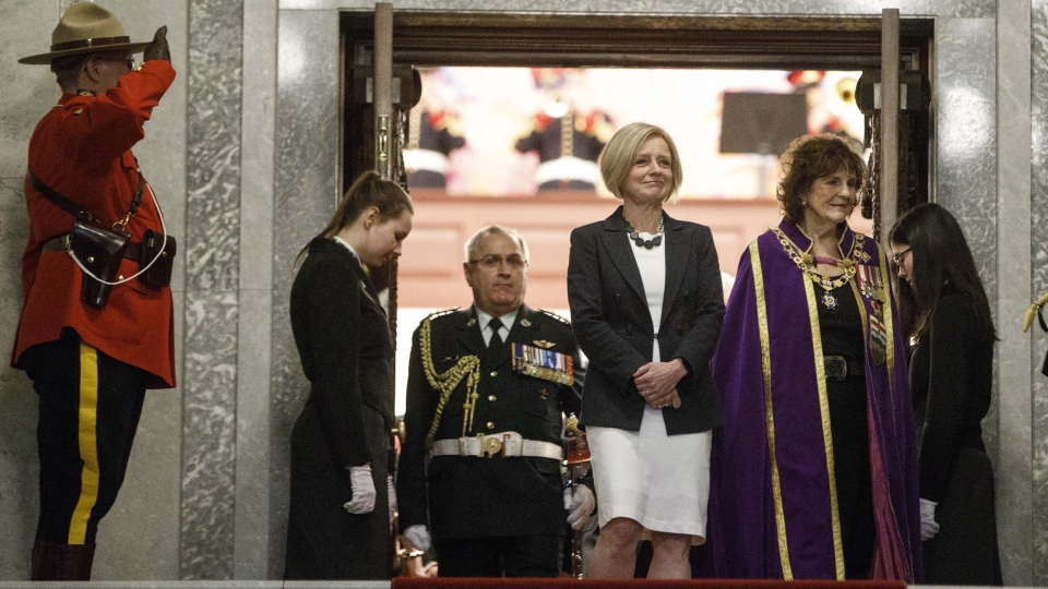 Alberta Premier Rachel Notley, left, and Alberta Lt.-Gov. Lois Mitchell come out of the house after the throne speech in Edmonton Alta, on Monday March 18, 2019. (THE CANADIAN PRESS/Jason Franson)