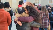 Anam Alvi embraces another student at a silent protest at the University of Toronto on March 18, 2019.