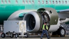 In this March 13, 2019, file photo a worker walks past an engine on a Boeing 737 MAX 8 airplane being built for American Airlines at Boeing Co.'s Renton assembly plant in Renton, Wash. (AP Photo/Ted S. Warren, File)