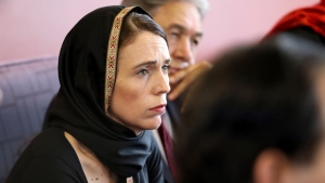 In this photo released by New Zealand Prime Minister's Office, Prime Minister Jacinda Ardern, left, speaks to representatives of the Muslim community, Saturday, March 16, 2019 at the Canterbury Refugee Centre in Christchurch, New Zealand. (New Zealand Prime Minister Office via AP)