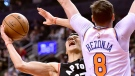 New York Knicks forward Mario Hezonja (8) fouls Toronto Raptors guard Jeremy Lin (17) on his way to the hoop during first half NBA basketball action in Toronto, Monday, March 18, 2019. THE CANADIAN PRESS/Frank Gunn