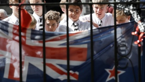 Students embrace at a floral tribute at the Botanical Gardens in Christchurch, New Zealand, Tuesday, March 19, 2019. (AP Photo/Mark Baker)
