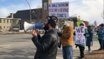 Protestors rally outside Smiths Falls town hall for the seventh consecutive week.