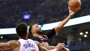 Toronto Raptors forward Norman Powell (24) drives to the net as New York Knicks forward Lance Thomas (42) looks on during first half NBA basketball action in Toronto, Monday, March 18, 2019. THE CANADIAN PRESS/Frank Gunn