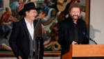 Kix Brooks, left, and Ronnie Dunn, of the duo Brooks and Dunn, appear during the annual announcement of inductees into the Country Music Hall of Fame Monday, March 18, 2019, in Nashville, Tenn. They will be inducted along with Ray Stevens and Jerry Bradley. (AP Photo/Mark Humphrey)