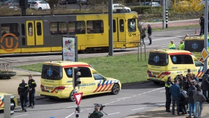Ambulances are seen next to a tram after a shooting in Utrecht, Netherlands, Monday, March 18, 2019. (AP Photo/Peter Dejong)