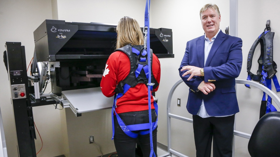 Dr. Brian Benson, right, tests Olympic wrestler Danielle Lappage following the announcement of comprehensive guidelines for concussions in high performance sport in Calgary, Alta., Monday, March 18, 2019. (Jeff McIntosh / THE CANADIAN PRESS)