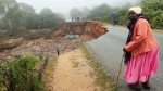 An elderly woman stands next to a collapsed bridge in Chimanimani, about 600 kilometers southeast of Harare, Zimbabwe, Monday, March 18, 2019. (AP Photo/Tsvangirayi Mukwazhi)