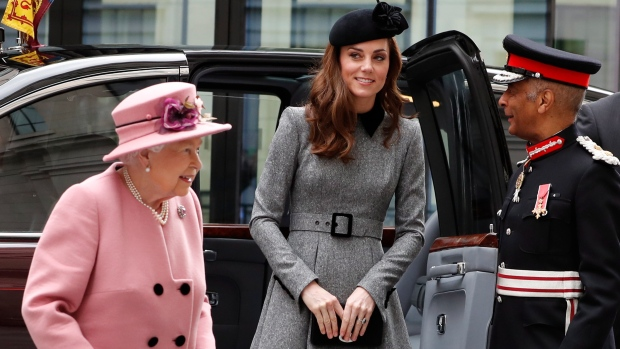 Queen Elizabeth II accompanied by Kate, Duchess of Cambridge arrives at Kings College in London, Tuesday, March 19, 2019. (AP Photo/Alastair Grant)