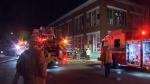 Crews respond to a blaze that broke out at a commercial laundry building on 4th Avenue and Ontario Street on Monday, March 18, 2019.