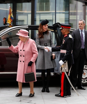 Queen Elizabeth II, waves to the crowd as she and Kate, Duchess of Cambridge arrive at Kings College in London, Tuesday, March 19, 2019. The Queen and Kate Duchess of Cambridge, will visit King's College London, Tuesday, to open Bush House, the latest education and learning facilities on the Strand Campus. (AP Photo/Alastair Grant)