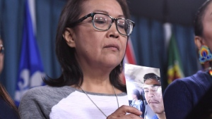 Debbie Baptiste, mother of Colten Boushie, holds a photo of her son during a press conference on Parliament Hill in Ottawa on February 14, 2018.  (Justin Tang / THE CANADIAN PRESS)