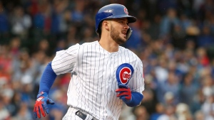 In this Sept. 28, 2018, file photo, Chicago Cubs' Kris Bryant rounds the bases after hitting a solo home run off of St. Louis Cardinals' Adam Wainwright during the fourth inning of a baseball game in Chicago. (AP Photo/Kamil Krzaczynski, File)