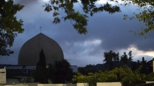 Al Noor mosque is shaded by clouds in Christchurch, New Zealand, Tuesday, March 19, 2019. Streets near the hospital that had been closed for four days reopened to traffic as relatives and friends of the victims of last week's mass shootings continued to stream in from around the world. (AP Photo/Vincent Thian)