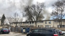 Black smoke drifts from the roof and windows of a Toronto Community Housing building in Etobicoke on March 19, 2019. (Peter Muscat/CTV News Toronto)