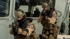 Naval Tactical Operations Group members conduct a boarding exercise on HMCS Charlottetown during Operation Reassurance in the Mediterranean Sea. (Royal Canadian Navy)