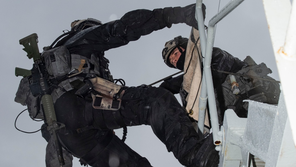 Members of the Naval Tactical Operations Group conduct rappel training on HMCS Toronto during Operation Reassurance, Feb. 6, 2019. (Royal Canadian Navy)
