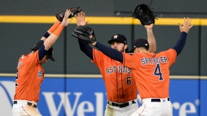 In this July 6, 2018, file photo, Houston Astros Josh Reddick, left, Jake Marisnick (6), and George Springer do a Fortnite celebration dance after the team's 11-4 win over the Chicago White Sox in a baseball game in Houston. (AP Photo/Eric Christian Smith)