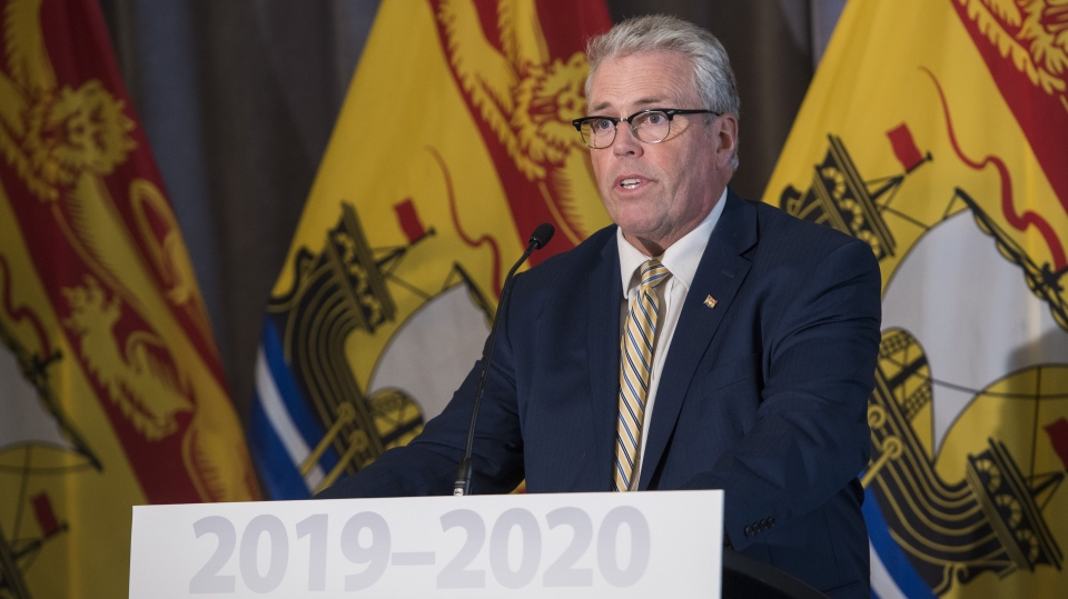 New Brunswick Finance Minister Ernie Steeves speaks at a press conference prior to delivering the provincial budget in the Legislature in Fredericton, New Brunswick on Tuesday March 19, 2019. (THE CANADIAN PRESS/Stephen MacGillivray)