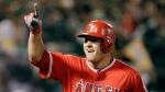 In this April 3, 2017, file photo, Los Angeles Angels' Mike Trout celebrates after hitting a two-run home run off Oakland Athletics' Kendall Graveman in the third inning of a baseball game in Oakland, Calif. (AP Photo/Ben Margot, File)