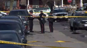 Emergency crews attend the scene of a shooting near Randolph and Perth avenues on March 19, 2019.