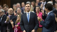 Prime Minister Justin Trudeau and MPs applaud as Finance Minister William Morneau rises to deliver the federal budget in the House of Commons in Ottawa, Tuesday March 19, 2019. THE CANADIAN PRESS/Sean Kilpatrick