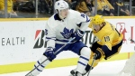 Toronto Maple Leafs right wing Mitchell Marner (16) is defended by Nashville Predators' Calle Jarnkrok (19), of Sweden, in the third period of an NHL hockey game Tuesday, March 19, 2019, in Nashville, Tenn. The Predators won 3-0. (AP Photo/Mark Humphrey)