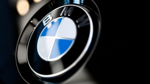 The logo of German car manufacturer BMW is pictured on a BMW car prior to the earnings press conference in Munich, Germany, Wednesday, March 20, 2019. (AP Photo/Matthias Schrader)