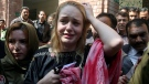 Czech model Tereza Hluskova, centre, reacts after appearing in court in Lahore, Pakistan, Wednesday, March 20, 2019. (AP Photo/K.M. Chaudary)