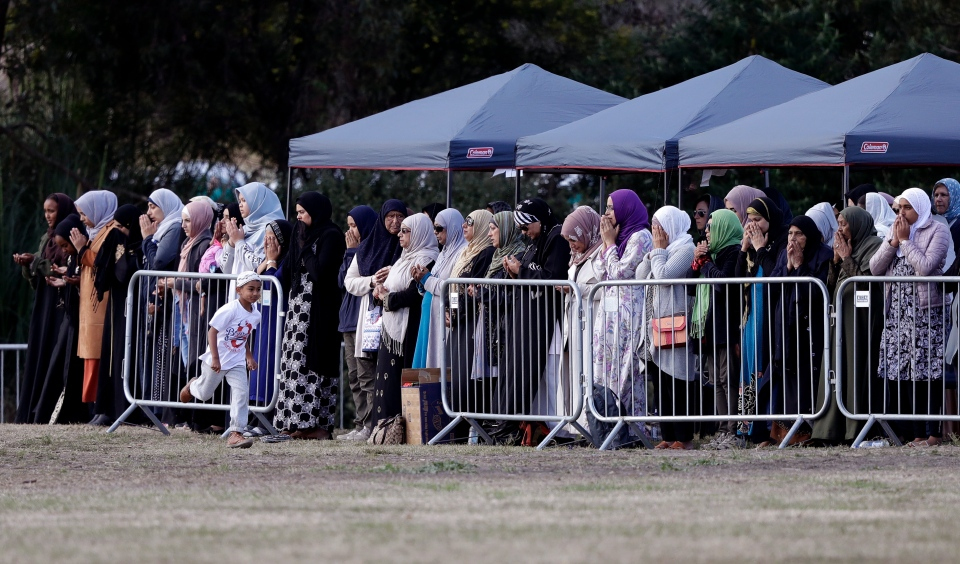 Women mourners pray during a funeral of a Friday March 15 mosque shooting victim at the Memorial Park Cemetery in Christchurch, New Zealand, Wednesday, March 20, 2019. (AP Photo/Mark Baker)