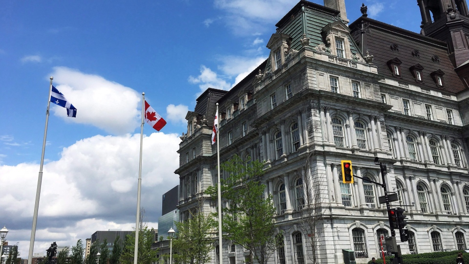 Flags fly outside of Montreal City Hall on June 7, 2018. (THE CANADIAN PRESS / Sidhartha Banerjee)