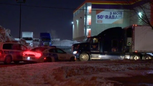 Two people are in custody and others are being questioned by police in connection with the attempted theft of a semi-truck in the West Island.