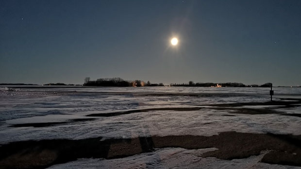 Niverville moon setting. Photo by Pete Hiebert.
