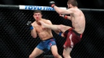 Russia's Khabib Nurmagomedov, right, kicks Al Iaquinta during the fourth round of a lightweight title bout at UFC 223 early Sunday, April 8, 2018, in New York. (AP Photo/Frank Franklin II)
