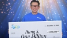 Lotto winner Hung Sengsouvanh poses with his $1 million cheque from the B.C. Lottery Corporation. (BCLC)